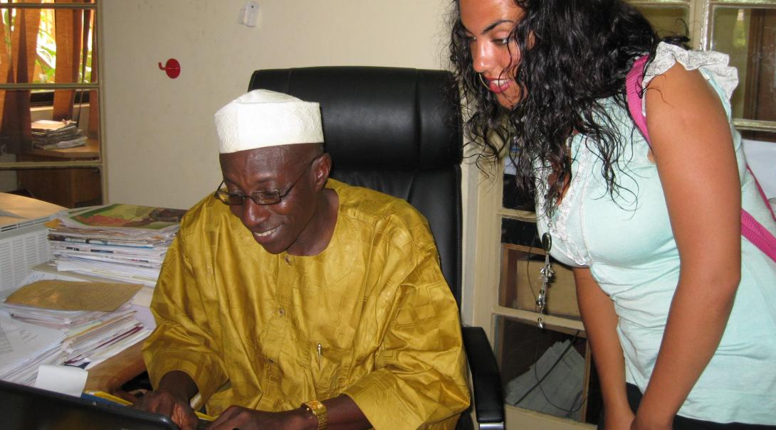 A Projects Abroad volunteer doing a journalism internship in Ghana write a story under the guidance of her supervisor